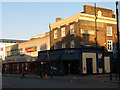 TQ3978 : Bar and shops on Woolwich Road by Stephen Craven