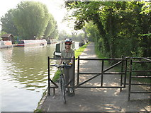 TQ1683 : Barrier to allow cycle access on canal towpath by David Hawgood