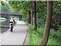 SK5639 : Nottingham Canal: cycling commuter by John Sutton