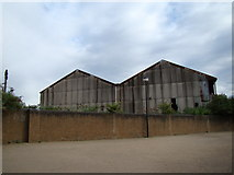 TQ3980 : View of the former warehouses from East India Dock by Robert Lamb