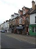 SO3014 : Shops at the bottom of Cross Street by John M
