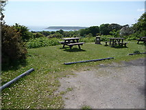 SS5288 : Car parking area and picnic tables in Penmaen village by Jeremy Bolwell