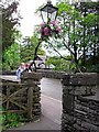 NY3307 : Flower decoration on church gate by Rose and Trev Clough