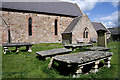 NT9130 : Tablestone graves in Kirknewton Churchyard by Walter Baxter