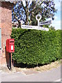 TG0329 : The Street Postbox & Roadsign by Geographer