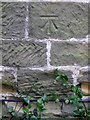 NZ3404 : Bench Mark, St Eloy's Church by Maigheach-gheal