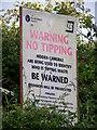 ST9500 : Flytipping sign near Sturminster Marshall by Maigheach-gheal