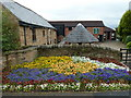 SK4081 : Ridgeway Craft Centre and spring floral display by Andrew Hill