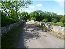 SP9599 : Wakerley Road bridge over the River Welland by Marathon