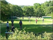SD9927 : Stilt-walking on the Salem cricket ground by Humphrey Bolton