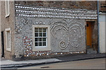 NO5603 : Decorated house wall, Anstruther by Jim Barton