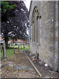 SE9182 : The east end of Snainton church, and a bench mark by John S Turner