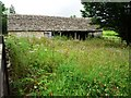 SP0712 : Flower-filled yard at Coulsty Barn by Christine Johnstone
