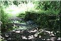 SW7017 : Footbridge over the stream below Erisey Barton by Rod Allday