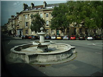 ST7565 : Fountain in the middle of the road at the junction of Great Pulteney Street and Laura Place by Robert Lamb