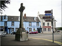 NX6851 : Memorial cross and signpost, Kirkcudbright by Rose and Trev Clough