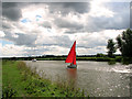 TG3815 : Red sails on the River Bure by St Benet's Abbey by Evelyn Simak