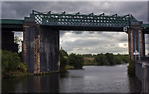 SJ7293 : The high level rail bridge over the Manchester Ship Canal by Ian Greig
