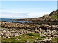 C9444 : Boulders on the shores of Port Granny by Eric Jones