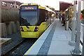 SJ8293 : Tram at St Werburgh's Road Metrolink stop, Chorlton by Phil Champion