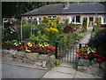NJ6201 : A front garden in Inchley Place by Stanley Howe