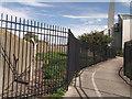 TQ4980 : Cycle finger post behind bars by David Anstiss