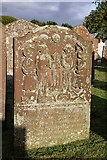 NX6248 : A symbolic gravestone in Borgue Parish Churchyard by Walter Baxter