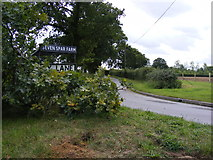 TM2557 : Sandy Lane & Seven Star Farm signs by Adrian Cable