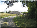 SX8478 : Barn by the track to Culverhouse Combe  by Robin Stott