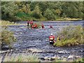 NZ0863 : Tyne & Wear Fire Brigade practice river rescue in River Tyne above Ovingham Bridge by Andrew Curtis