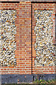 TL5746 : Detail of flint & brick wall by M H Evans