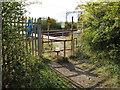 TQ7885 : Stile to railway crossing by Roger Jones