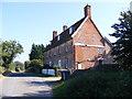 TM3341 : Grange Farm Cottages by Geographer