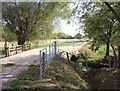 SP1648 : Bridge over stream on Monarch's Way footpath by David P Howard
