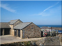 SW3526 : Fishermen's store sheds on the harbour at Sennen Cove by Rod Allday