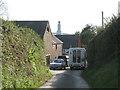 SX8349 : A schoolchild arrives back home, Ash  by Robin Stott
