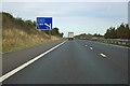 TL4744 : M11 - 1 mile sign for junction 10 by Robin Webster
