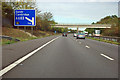 TL4254 : M11 - 1 mile sign junction 12, and overbridge by Robin Webster