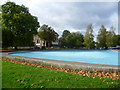 TQ2975 : Holy Trinity Church, Clapham Common across the paddling pool by Marathon