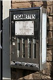 NT9261 : An old cigarette machine at Ayton by Walter Baxter