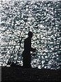 SZ2990 : Milford on Sea: an angler in silhouette by Chris Downer