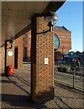 TQ2850 : Pillars outside McDonald's, Redhill by Derek Harper