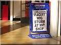 TQ3265 : Racist wig storm at 99p shop by Christopher Hilton