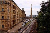 SE1338 : The railway passes Salts Mill by Steve Daniels