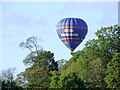 SK0021 : Balloon across the trees, Staffordshire by Roger  Kidd