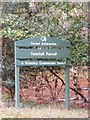 TM3854 : Tunstall Forest sign by Adrian Cable