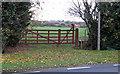 TL9000 : Gate, stile, footpath marker by Roger Jones