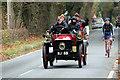 TQ2728 : 1902 Wolseley Tonneau driving through Staplefield - 2011  by Christine Matthews