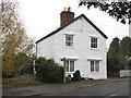 TQ9599 : Footpath near weatherboarded house by Roger Jones