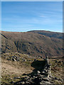 NY3508 : Dry stone wall descending from Heron Pike by Trevor Littlewood